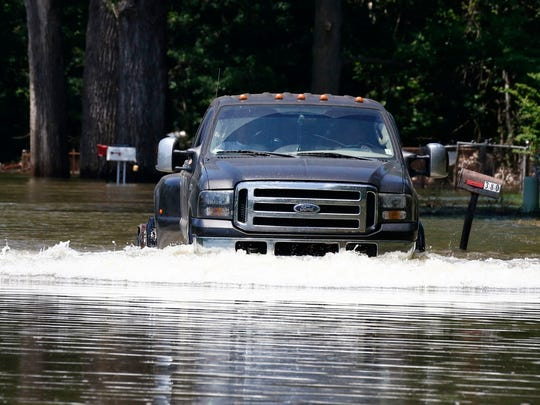 A resident drives his truck from their flooded property along Chickasaw Road in Warren County, near Vicksburg Monday. MDOT crews will close a section of State Route 465 from U.S. Highway 61 to the backwater levee in Warren County on Tuesday, based on the Mississippi River's forecasted crest of 48 feet on May 19, at Vicksburg.