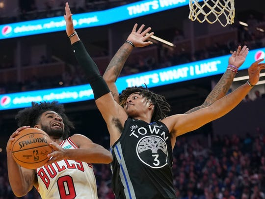 Chicago Bulls guard Coby White (0) shoots the basketball against Golden State Warriors guard Jordan Poole (3) during the second quarter at Chase Center.