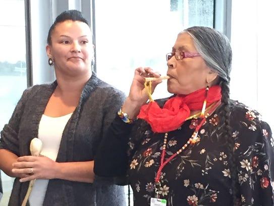 Medicine woman Mona Stonefish, right, of the Chippewa