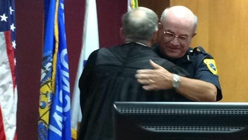 Interim Green Bay Police Chief Jim Lewis, right, hugs Brown County Circuit Judge Donald Zuidmulder after being sworn in on Monday.