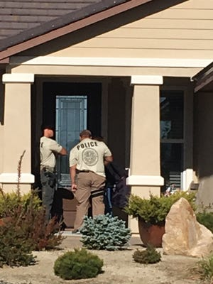 Law enforcement personnel question neighbors of Stephen Paddock's northwest Reno home Monday, Oct. 2, 2017. Paddock owned the home on Del Webb Parkway in Reno's Somersett neighborhood.