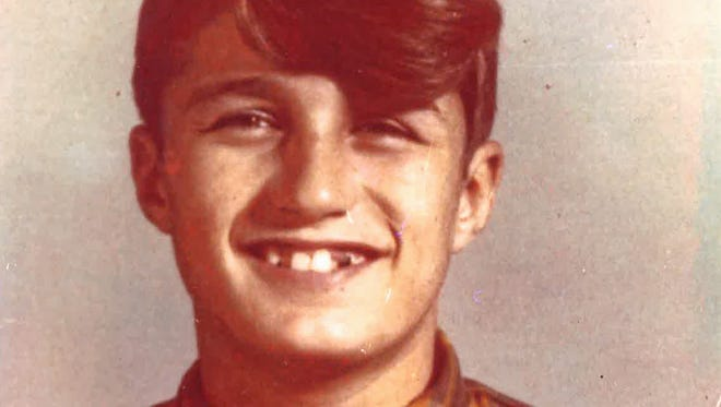 Dennis Buttry, in a photo before he was sent to Woodsbend Boys Camp in 1972, where he was killed.