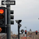 This red light camera is at intersections of 6th Avenue, Speer and Lincoln in Denver. A debate over whether to ban red-light and speed cameras heats up in the final days of the Colorado legislative session as lawmakers try to decide how to approach the issue.