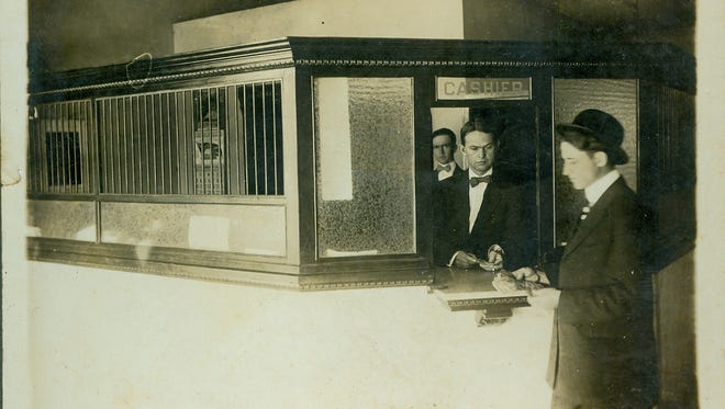 Dennis S. Hudson Sr. behind a teller cage at Bank of Boynton in 1925.