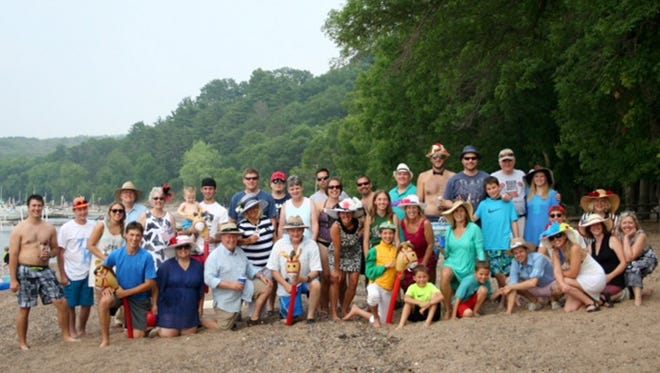 The Murr family poses for a family photo at their cabin on the St. Croix River.