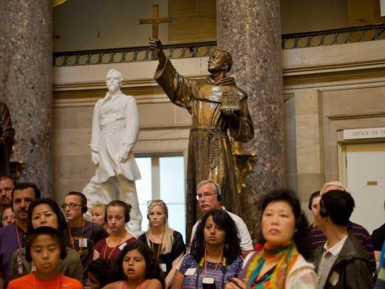 The statue of missionary Junipero Serra, center, is