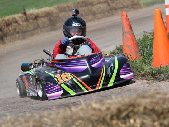 A young driver speeds around the  track during Go-Kart