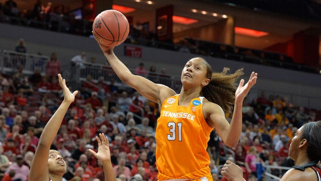 Tennessee's Jaime Nared grabs a rebound between Louisville's Ciera Johnson, left, and Myisha Hines-Allen during the first half of Monday's second-round NCAA Tournament women's basketball game in Louisville, Ky.