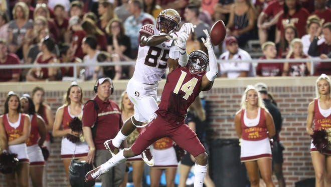 FSU's Keith Gavin and Kyle Meyers battle for a ball during the Seminoles' Garnet and Gold Spring Game at Doak Campbell Stadium on Saturday, April 14, 2018