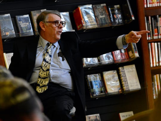 Professional auctioneer Gary Gladfelter directs bidding