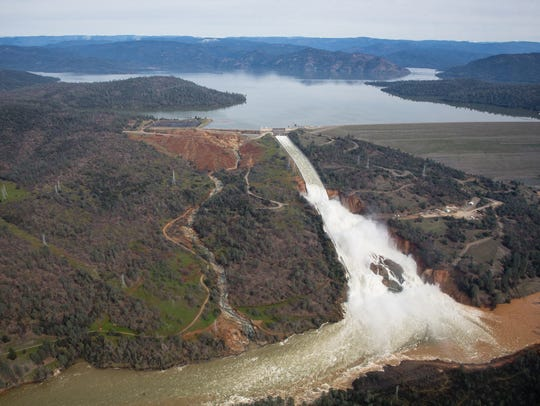 Oroville lake, the emergency spillway, and the damaged