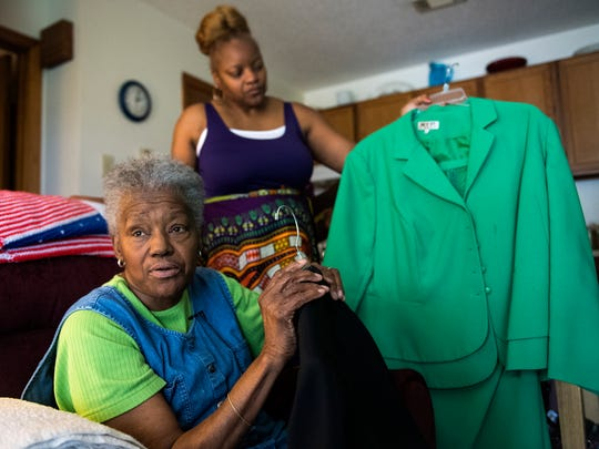 Betty Watson shows how she marks outfits to tell them apart in her home on Tuesday, July 18, 2017.