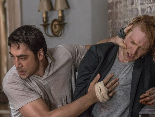 Javier Bardem (left) roughs up Domhnall Gleeson in