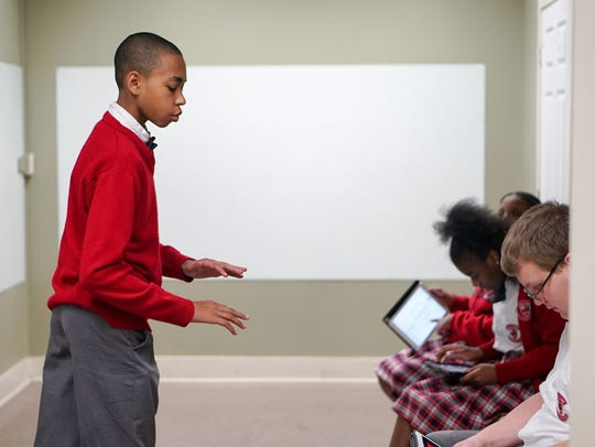 A T.M. Landry College Prep student leads during a class