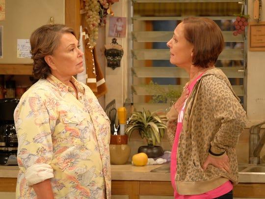 Roseanne (Roseanne Barr), left, and her sister, Jackie