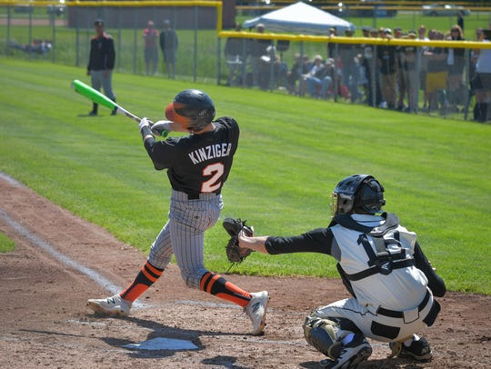 Jack Kinziger (2) of Ripon swings at a pitch against