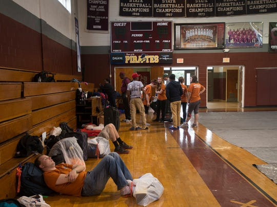 Sam Sullivan sleeps in the gymnasium at St. Jude in Montgomery, Ala., while participating in a commemorative march of the 1965 Selma to Montgomery March as part of the National Parks Service 50th Anniversary Walking Classroom on Tuesday, March 24, 2015.