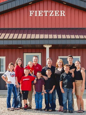 The third and fourth generations of the Fietzer family include: Craig and Melissa (left) and their children Amber, Brandon, Nathan and Grant; Kyle and Cindy, and their children Alex, Brody, Jasmine and Patrick.