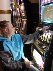 Kaylee Ledbetter, 23, of Indianapolis, plays the slot