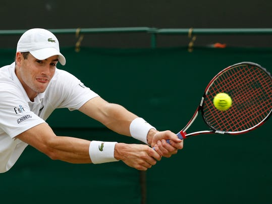 John Isner of the U.S. plays a return to Feliciano Lopez of Spain during their men's singles match at the All England Lawn Tennis Championships in Wimbledon, London, Monday, June 30, 2014. (AP Photo/Sang Tan)
