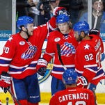 Amerks rookie Joel Armia (center) says speculation in a report out of Finland about his unhappiness and being homesick were unfounded and untrue.