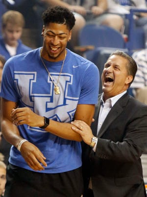 Kentucky head coach John Calipari, right, laughs with former Kentucky player Anthony Davis, of the New Orleans Pelicans, during the school's NCAA college basketball Big Blue Madness event, Friday, Oct. 16, 2015, in Lexington, Ky. (AP Photo/James Crisp)