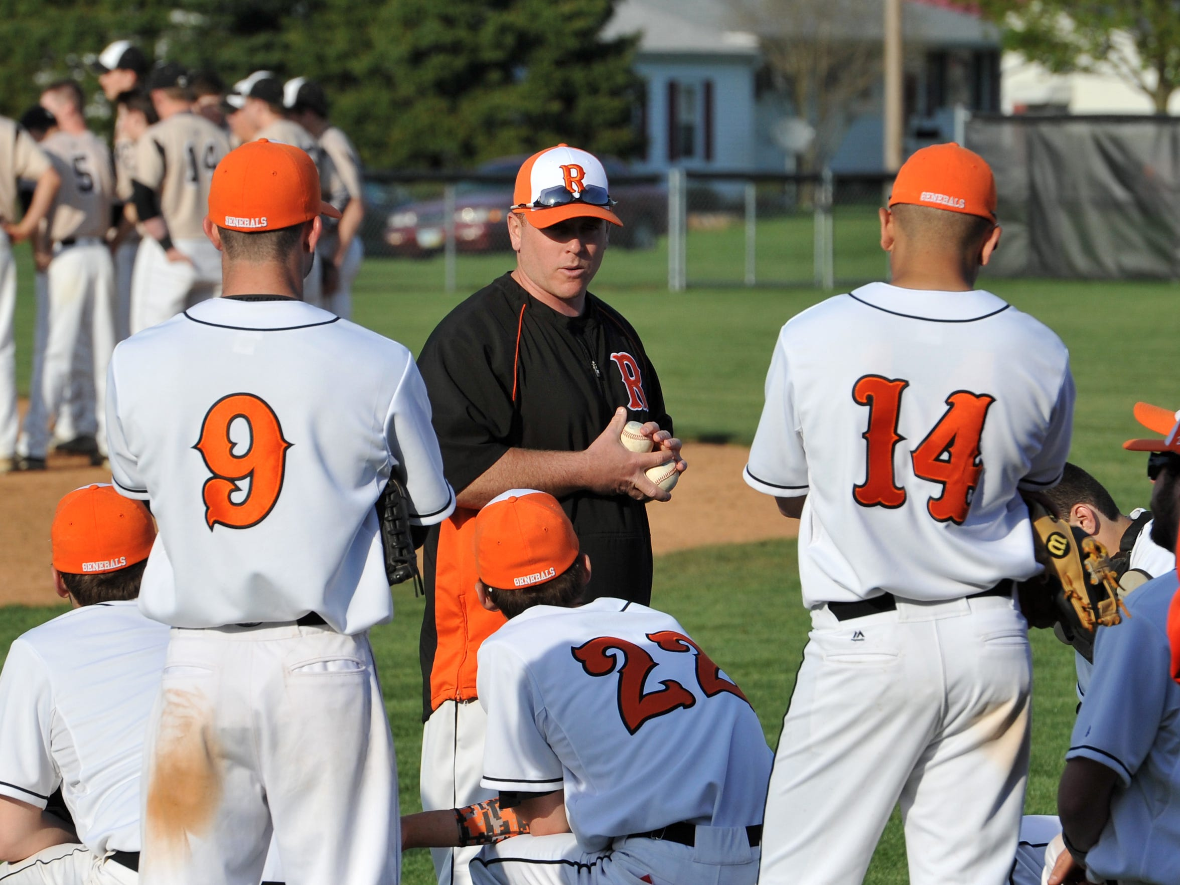 Ridgewood Varsity Baseball Coach Chad Lahna talks with his players after their 2 to 1 victory over TCC Tuesday evening.