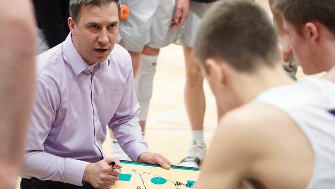 North Kitsap basketball coach Scott Orness draws up a play Saturday against Cheney.