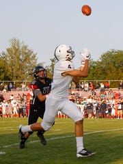 East Lansing's Blake Underwood, right, catches a pass