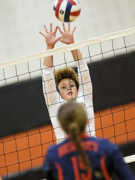 Palmyra's Kirstin West goes up for a block to help Palmyra stay unbeaten on Tuesday night.