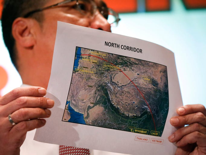 Acting Malaysia Transport Minister Hishamuddin Hussein displays a map of the northern search corridor during a news conference on the missing Malaysia Airlines jet at a hotel near the Kuala Lumpur International Airport on March 17 in Sepang. A Boeing 777 jet with 239 people on board disappeared on March 8.