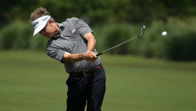 David Toms hits an approach during the second round of the Zurich Classic of New Orleans at TPC Louisiana on Friday at Avondale, Louisiana.