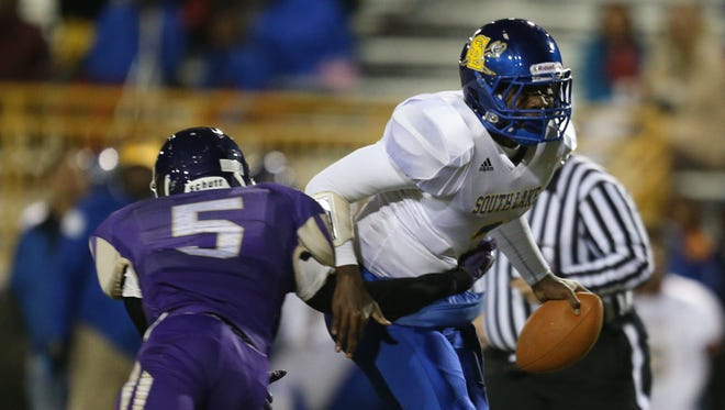 St. Clair Shores South Lake's Datrell Milling is pressured by Madison Heights Madison's Terrance Brown on Oct. 16, 2015, in Madison Heights.