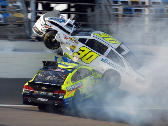 Parker Kligerman's No. 30 Toyota gets launched on top of Paul Menard's No. 27 Chevrolet in a multicar crash during Wednesday's Daytona 500 practice.