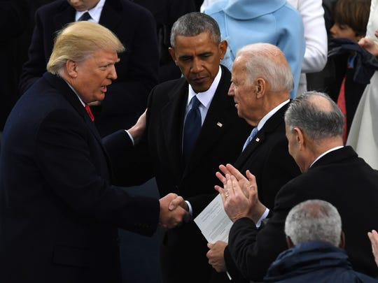 President Donald Trump (left) shakes hands with former president Barack Obama (center) and former vice president Joe Biden after being sworn in as president on January 20, 2017 at the U.S. Capitol in Washington, DC.