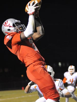 Red Devil senior receiver Nai Carlisle hauls in the ball late in the first half Friday night.