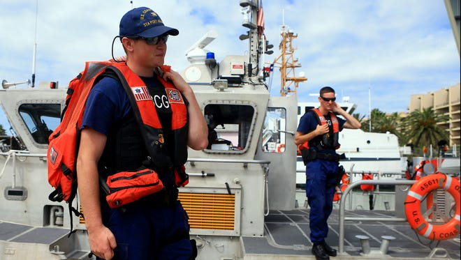 Petty Officer Gus Huddleston (left) and Petty Officer Lance Harvey from the US Coast Guard prepare to patrol the Gulf of Mexico waters during spring break Wednesday, March 15, 2017, at Port Aransas.