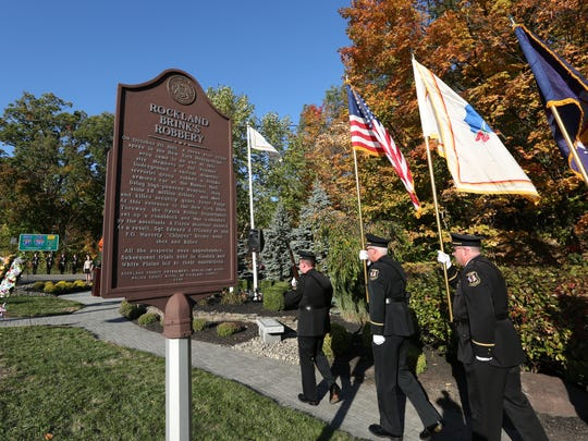 The Clarkstown police Honor Guard presents the colors during the 34th annual Brinks Memorial Service in Nyack on Oct. 20. The event remembered South Nyack police Sgt. Edward O'Grady and Officer Waverly Brown, and Brinks guard Peter Paige, who were killed in an armored-car robbery in 1981.
