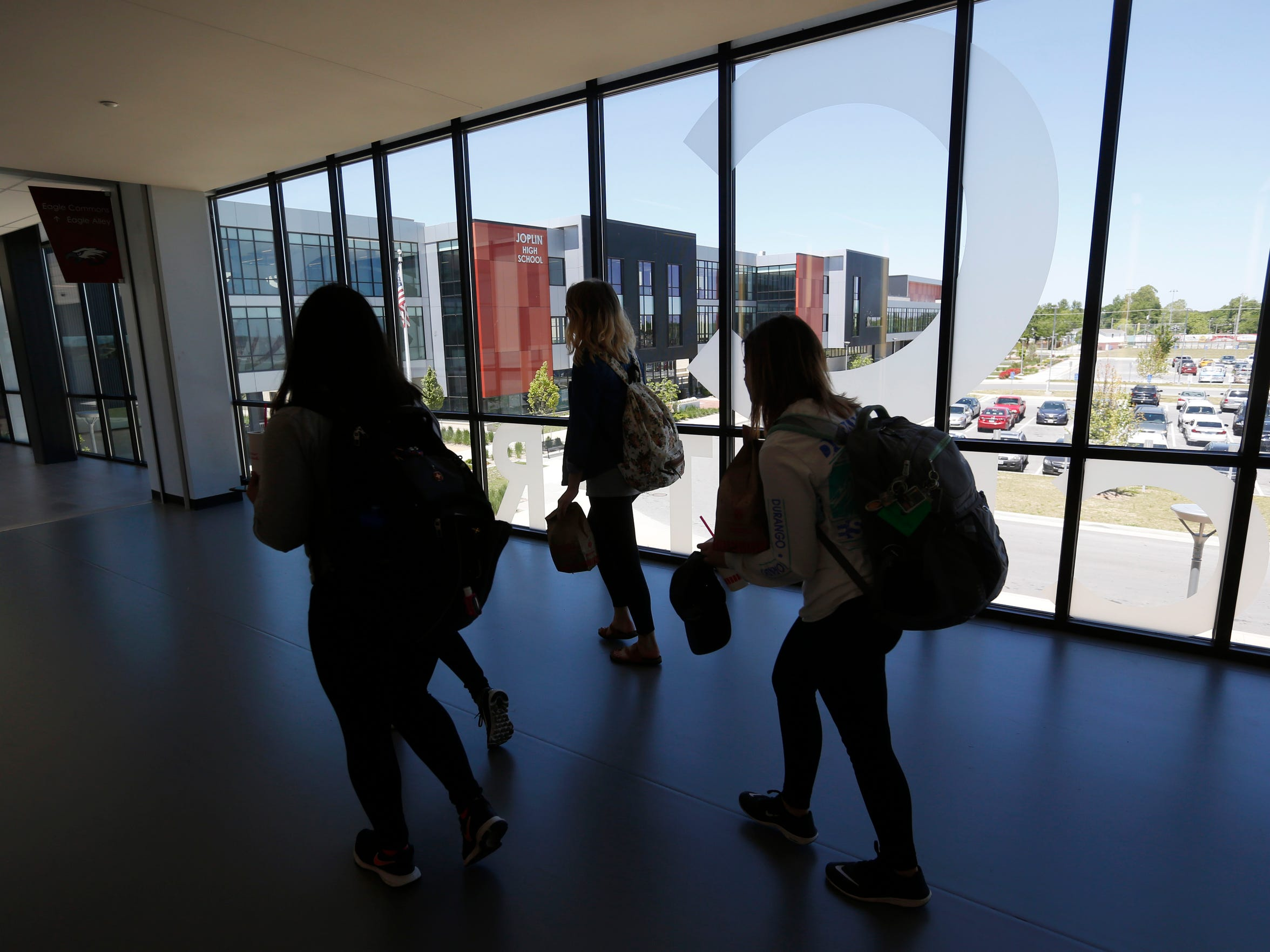 Students walk to class down a concourse lined with