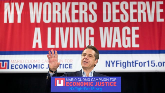 New York Gov. Andrew Cuomo speaks during a rally to raise the minimum wage Thursday in Albany.