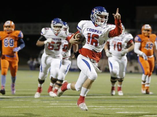 Abilene Cooper quarterback Ender Freeman points to