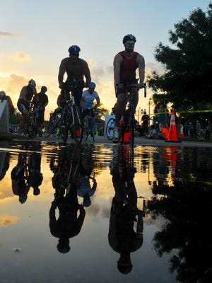 Triathletes head out for the bike portion,  during Sunday morning's Ron Jon Surf Shop Cocoa Beach Triathlon held at Cocoa Beach Country Club.