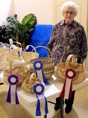 Leona Waddell with her award-winning baskets at the