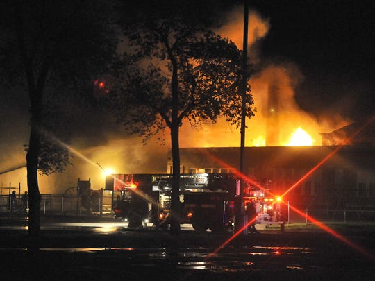 Firefighters from as many as five departments battled the blaze at Roosevelt Education Center early on June 15.
