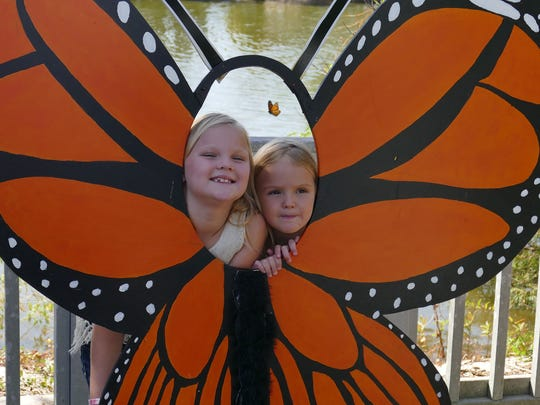 Caroline and Ava Davis created a two-headed monarch butterfly photo opportunity during a previous Monarch Madness Butterfly Festival. This year's festival is set for Saturday.