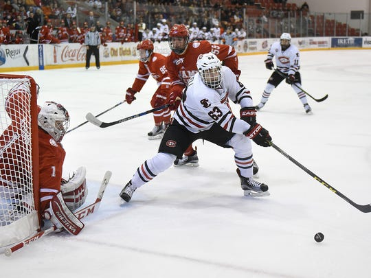 St. Cloud State's Patrick Russell tries to get control of the puck in front of Miami goaltender Jay Williams at the Herb Brooks National Hockey Center. Russell was second on the team in goals (20) and third in points (41) as a sophomore. He signed a two-year contract with the Edmonton Oilers on Monday.