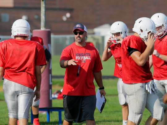 Tony Grandinetti, head coach, coaches his team during