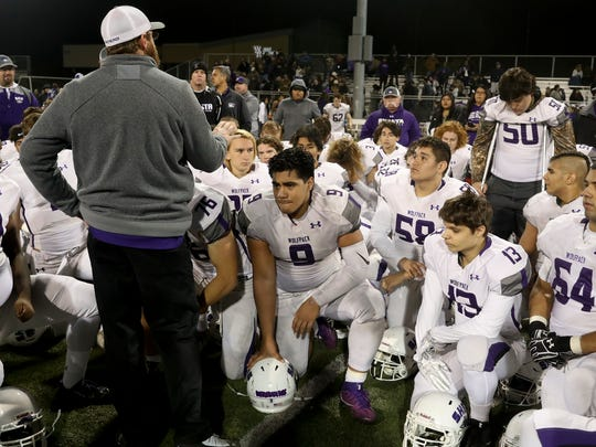 Shasta Wolves head football coach J.C. Hunsaker thanks the team for all their hard work this season after the Wolves 41-6 loss Saturday to Bishop Diego.