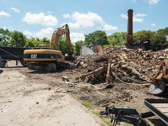 Construction crews work on demolishing the remains of the Chicory Warehouse Thursday, June 28, 2018. The warehouse was destroyed in a fire Friday evening.