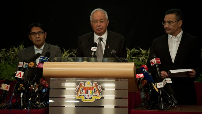 Malaysian Prime Minister Najib Razak delivers a statement on the missing Malaysia Airlines Flight 370 during a press conference in Kuala Lumpur on March 24.